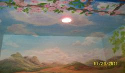 front of ceiling of scottish highlands mural